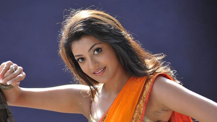 Kajal Aggarwal Smiling N Looking At Camera In Businessman