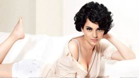 Kangna Ranaut Laying Pose N Looking At Camera