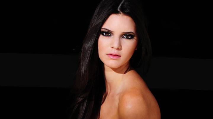 Kendall Jenner Side Pose In Pink Lips N Black Background