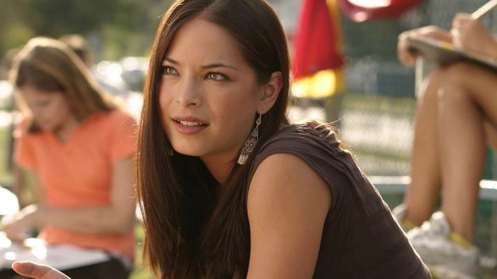Kristin Kreuk Looking Somthing N Sitting Pose