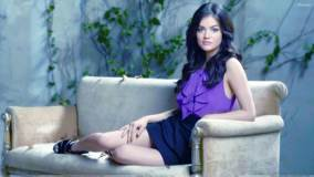 Lucy Hale Sitting Pose On Sofa In Purple Top N Skirt