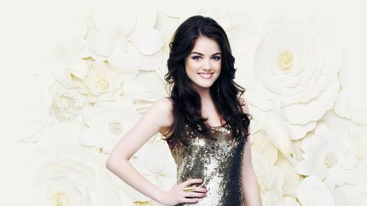 Lucy Hale Smiling Modeling Pose In Golden Dress