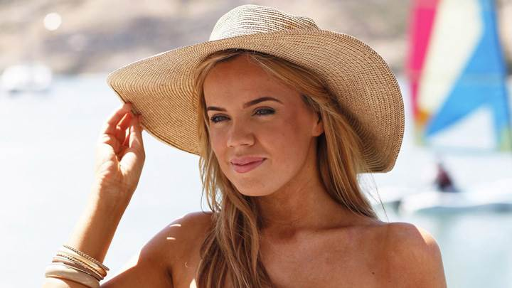 Maria Fowler In Wooden Hat Smiling Face Photoshoot