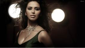 Meenakshi Dixit Looking At Camera N Wearing Necklace Photoshoot