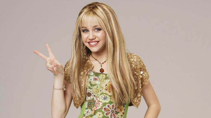 Miley Cyrus Showing Two Fingers Sweet Smiling Photoshoot