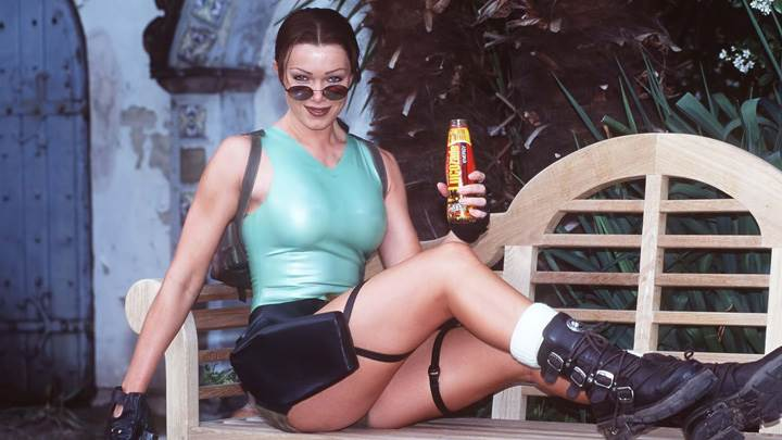 Nell McAndrew as Lara Croft Sitting Pose At Tomb Raider Promos