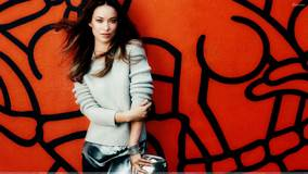 Olivia Wilde In Woollen Top N Red Background