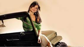 Penelope Cruz Sitting Pose on Jeep
