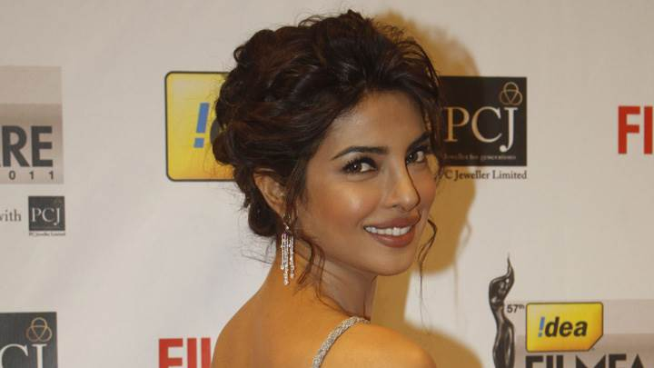 Priyanka Chopra Smiling Looking Back At Filmfare Awards 2012 Red Carpet