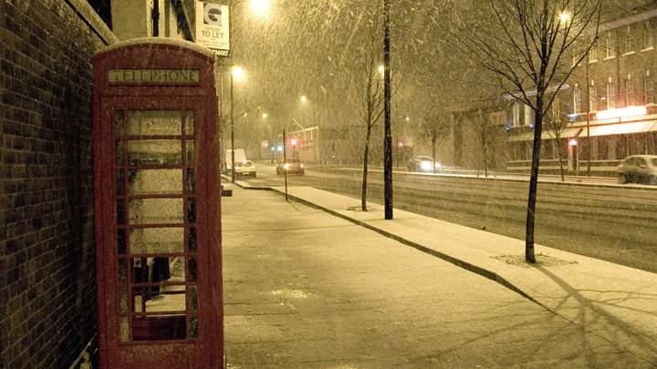 Red Telephone Booth On Side Of The Street