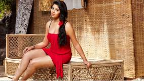 Richa Gangopadhyay Sexy Sitting Pose In Red Dress