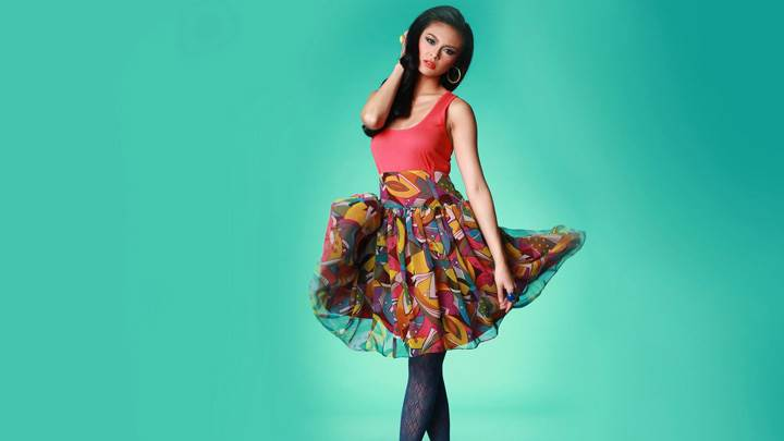 Samuelle Lynne Acosta In Colorful Dress N Green Background