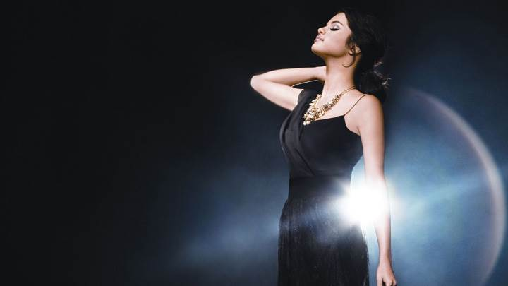 Selena Gomez Closed Eyes In Long Black Dress Side Photoshoot