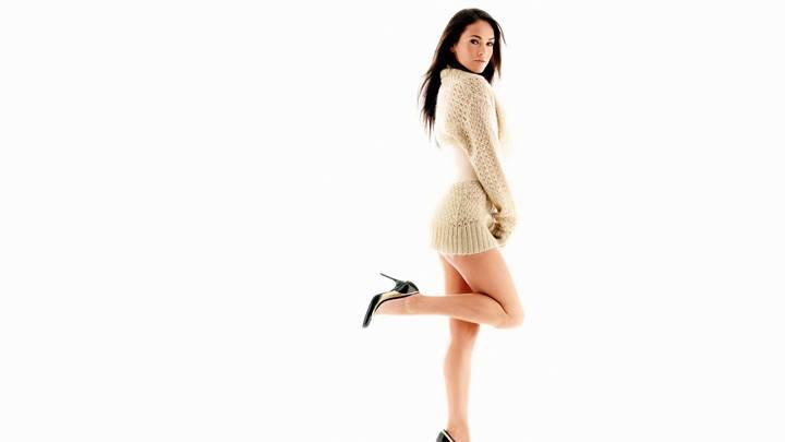 Side Pose Of Megan Fox In Woollen Top N White Background