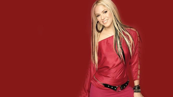 Shakira Smiling In Red Dress N Red Background
