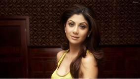 Shilpa Shetty Side Front Pose in Yellow Top