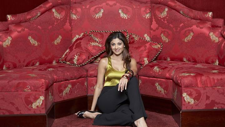 Shilpa Shetty Sitting Near Red Sofa