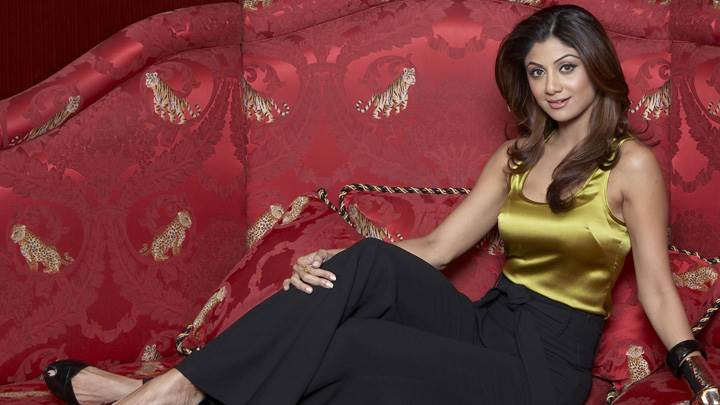 Shilpa Shetty Sitting on Sofa in Lemon Top