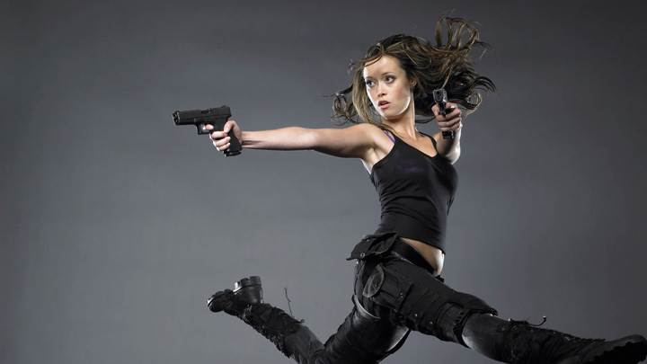 Summer Glau Shooting With Gun In Black Dress N Grey Background