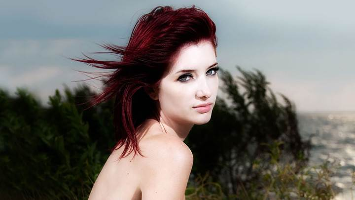 Susan Coffey Sitting Near Sea Side N Side Pose Photoshoot