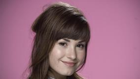 Demi Lovato Cute Smiling Face N Pink Background