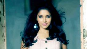 Smiling Face Of Asin In Pink Top