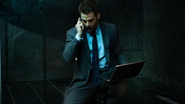 Chris Pine Sitting On Floor In Grey Suit Laptop In Hand