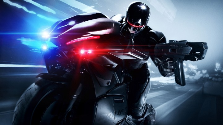 Joel Kinnaman On Bike With A Gun In RoboCop