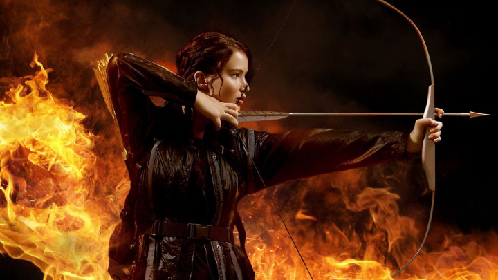 Katniss Everdeen With Her Bow Aiming At Something