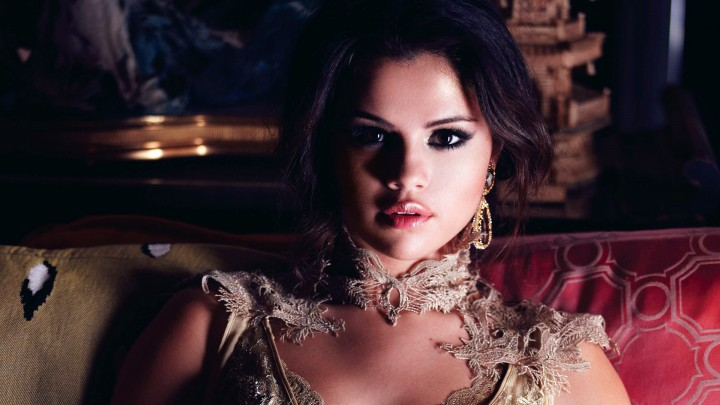 Selena Gomez In Classic Dress Pink Lips Sitting Pose