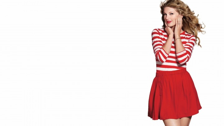 Taylor Swift In Red Stripe Dress Making A Cute Pose