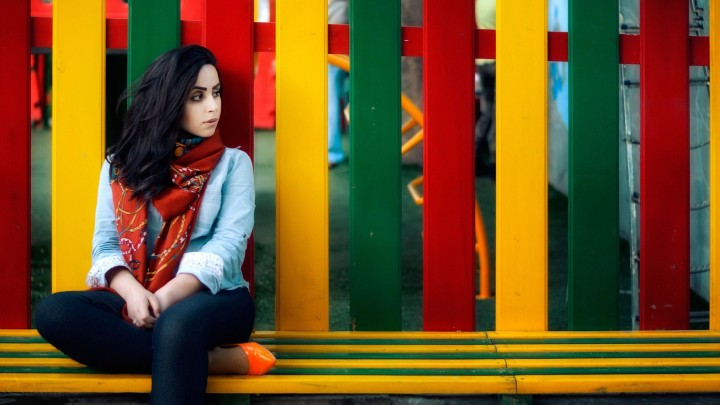 Armenia Ann Sitting On Bench Behind Colorful Fence