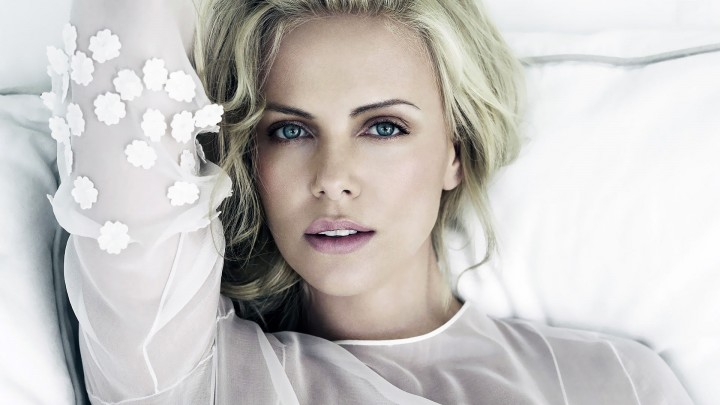 Charlize Theron Laying Pose In White Dress