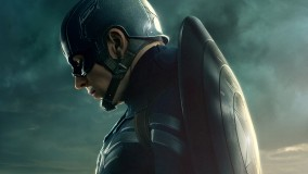 Chris Evans Side Pose With Mask On Face And Shield On Back