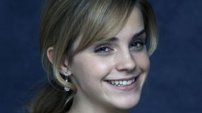 Cute Smiling Emma Watson Wearing Diamond Earrings