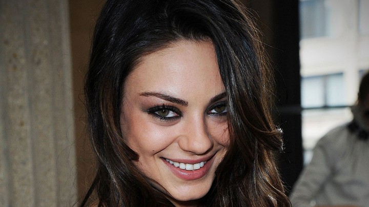 Mila Kunis Looking Scary With Her Smiling Look