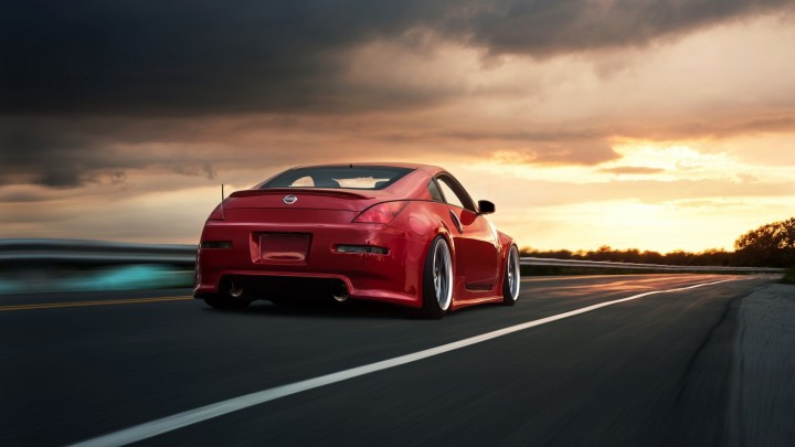 Red Nissan 350Z Running On Road