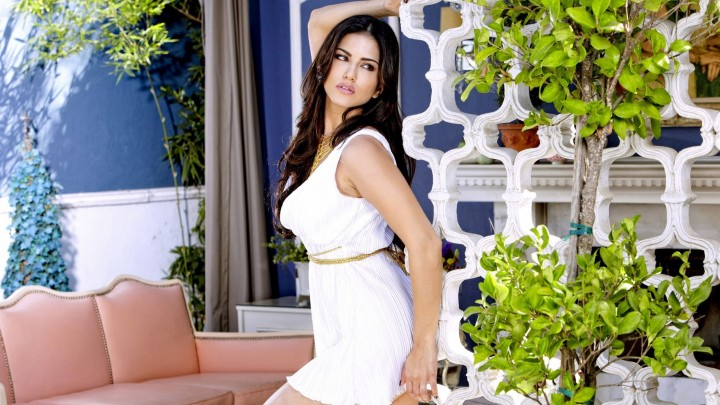 Sunny Leone Side Pose Looking Beautiful In White Dress