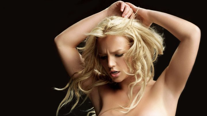Britney Spears Golden Hairs Looking Down N Black Background